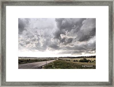 Opposite The Storm Framed Print