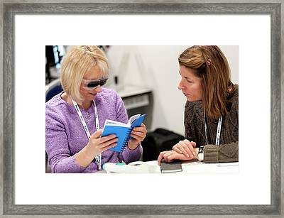 Optometry Conference Delegates Framed Print by Dan Dunkley