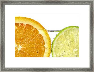 Orange And Lime Slices In Water Framed Print