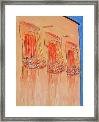 Orange Balcony Framed Print by Marcia Meade