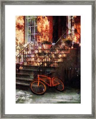 Orange Bicycle By Brownstone Framed Print by Susan Savad