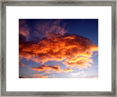Orange Clouds Framed Print by The Harrington Collection