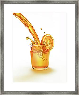 Orange Juice Being Poured Into A Glass Framed Print by Leonello Calvetti