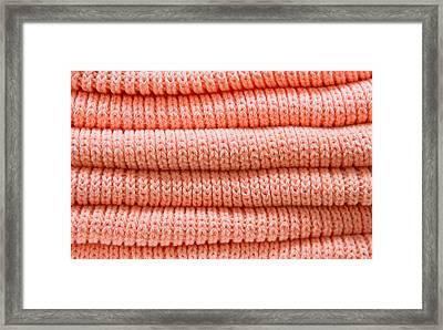 Orange Sweaters Framed Print