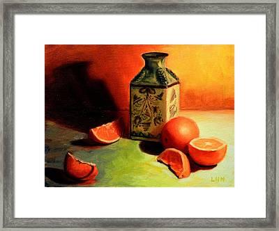 Orange Temptation Framed Print