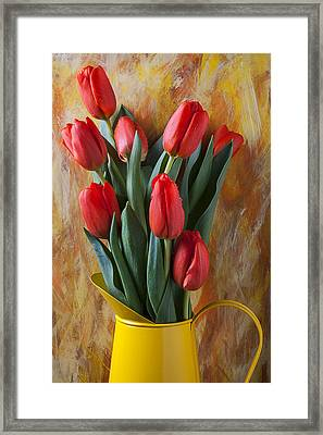 Orange Tulips In Yellow Pitcher Framed Print by Garry Gay