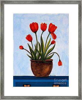 Orange Tulips On A Blue Buffet Framed Print by Barbara Griffin