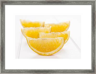 Orange Wedges On White Background Framed Print