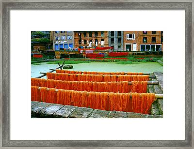 Orange Yarn Framed Print