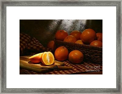 Oranges Framed Print by Olivier Le Queinec