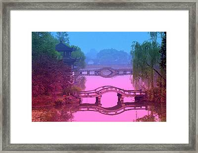 Oriental Bridge Framed Print by Larry Moloney