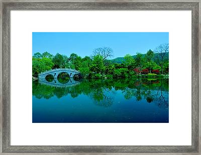 Oriental Bridge Over West Lake Framed Print by Larry Moloney