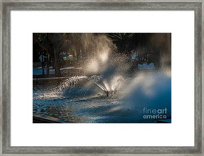 Ornamental Fountain In A Pond With Blurred Light Reflections Framed Print