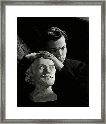 Orson Welles Resting On A Sculpture Framed Print by Cecil Beaton