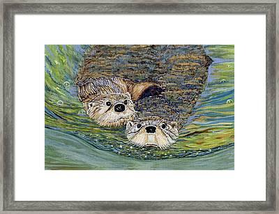 Otter Pals Framed Print by Sandra Wilson