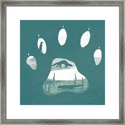 Otter Paw Framed Print by Daniel Hapi