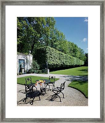 Outdoor Furniture In The Backyard Of Mr. And Mrs Framed Print by Andr? Kert?sz