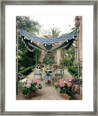 Outdoor Furniture On A Terrace Framed Print by Tom Leonard