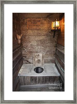 Outhouse Interior Framed Print