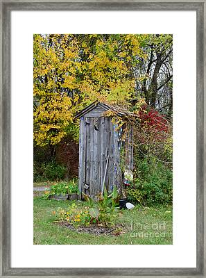 Outhouse Surrounded By Autumn Leaves Framed Print