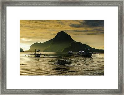 Outrigger At Sunset In The Bay Of El Framed Print by Michael Runkel