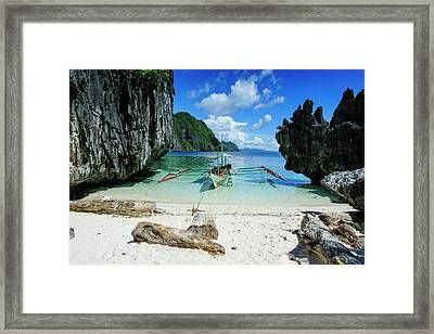 Outrigger Boat On A Little White Beach Framed Print by Michael Runkel