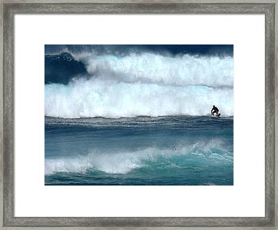 Outrunning The Wave Framed Print