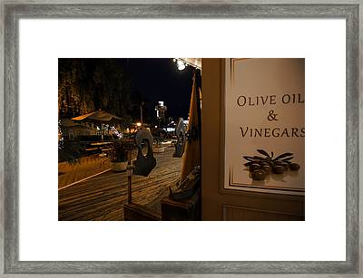 Outside The Oil And Vinegar Shop Framed Print