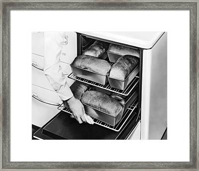 Oven Fresh Warm Bread Framed Print by Underwood Archives