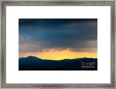 Overcast Dark Sky Rain Clouds With Yellow Glow Beyond Hills On H Framed Print