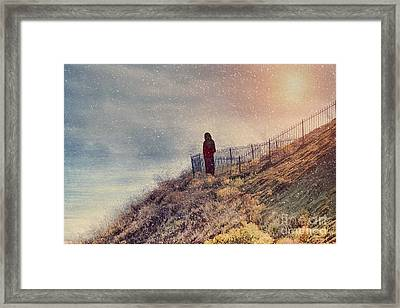 Overlooking The Wintery Sea Framed Print by Susan Gary