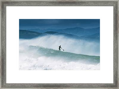 Paddleboarding In The Waves Along The Framed Print by Ben Welsh