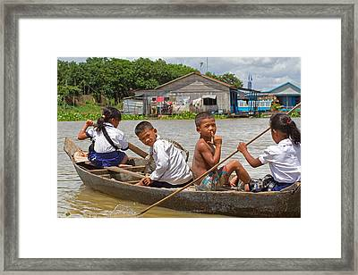 Paddling Home From School Framed Print by David Freuthal