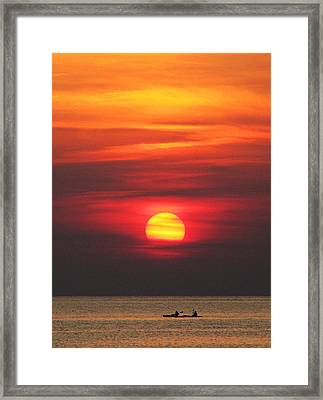 Paddling Under The Sun Framed Print