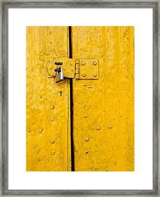 Padlock On An Old Yellow Door Framed Print