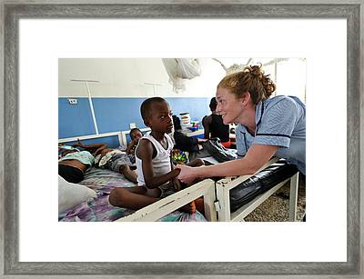Paediatric Nursing In Sierra Leone Framed Print by Matthew Oldfield