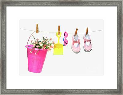Pail And Shoes On White Framed Print by Sandra Cunningham