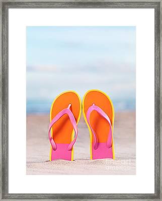 Pair Of Bright Orange Flip Flops At The Beach Framed Print by Oleksiy Maksymenko