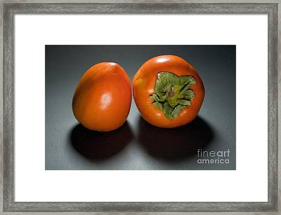 Pair Of Persimmons Framed Print by Dan Holm
