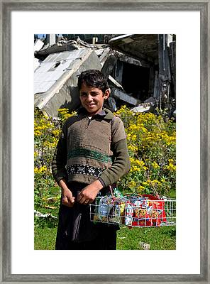 Framed Print featuring the photograph Pakistani Boy In Front Of Hotel Ruins In Swat Valley by Imran Ahmed