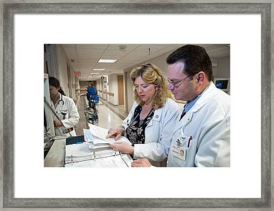 Palliative Nurse And Doctor Framed Print by Jim West