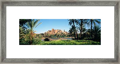 Palm Trees With A Fortress Framed Print