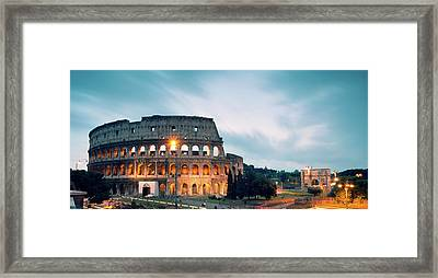 Panoramic Of The Colosseum At Night Framed Print by Matteo Colombo