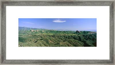 Panoramic View Of Green Rolling Hills Framed Print by Panoramic Images