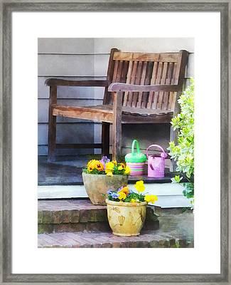 Pansies And Watering Cans On Steps Framed Print by Susan Savad