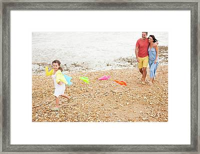 Parents On Beach With Daughter Framed Print