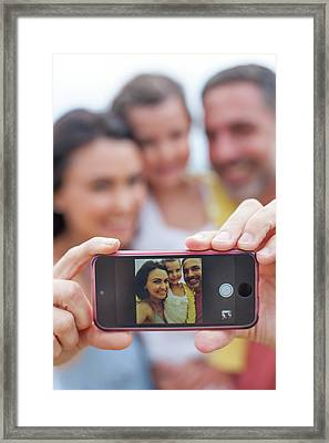 Parents Taking Family Photograph Framed Print