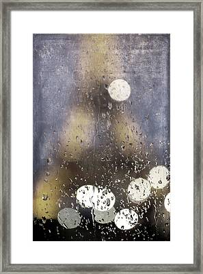 Paris In The Rain Framed Print by Evie Carrier