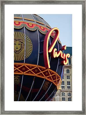 Paris Lights Framed Print by John Rizzuto