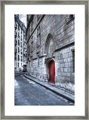 Paris Red Door Framed Print by Evie Carrier